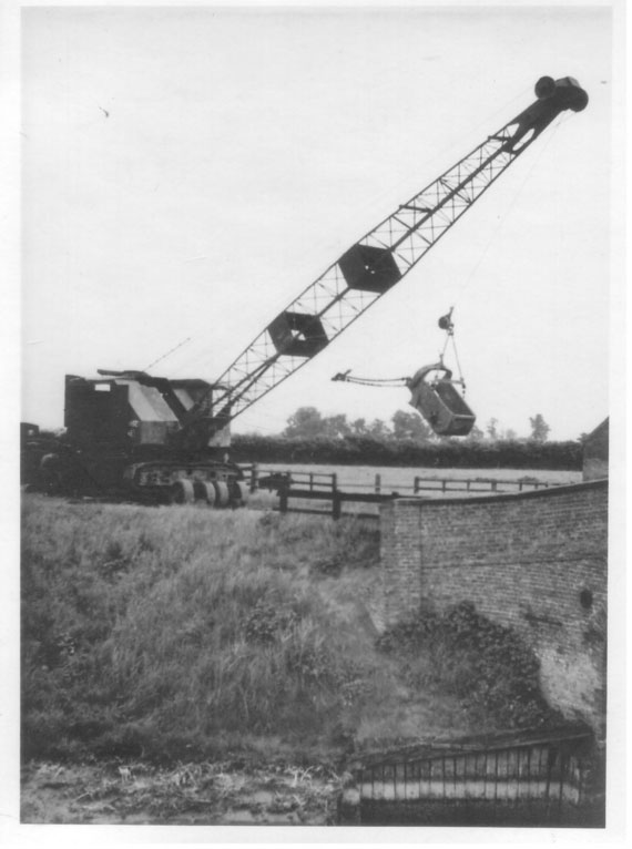 Historic image: an old dragline machine working on the maintenance of drain banks in South Holland