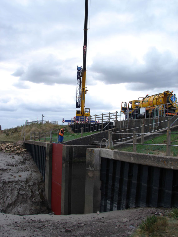 A piling rig working at Lutton Leam Sluice on the River Nene, South Holland IDB.