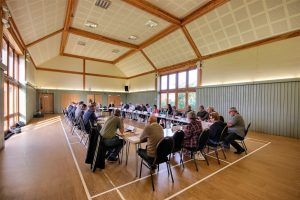 Members of the Broads IDB seated at a Board Meeting held at Hickling Barn community centre in the Norfolk Broads