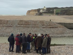 A group of Board members visiting the mouth of the River Cuckmere