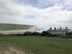 The Coastguard Cottages at Cuckmere Haven, with views of the white cliffs of the Severn Sisters which stretch between the mouth of the Cuckmere River and Eastbourne