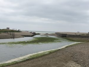 The build-up of shingle at the mouth of the Cuckmere River