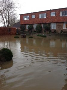 Flooded residential street in Alfriston, East Sussex, due to heavy rain fall inundating the Cuckmere River.